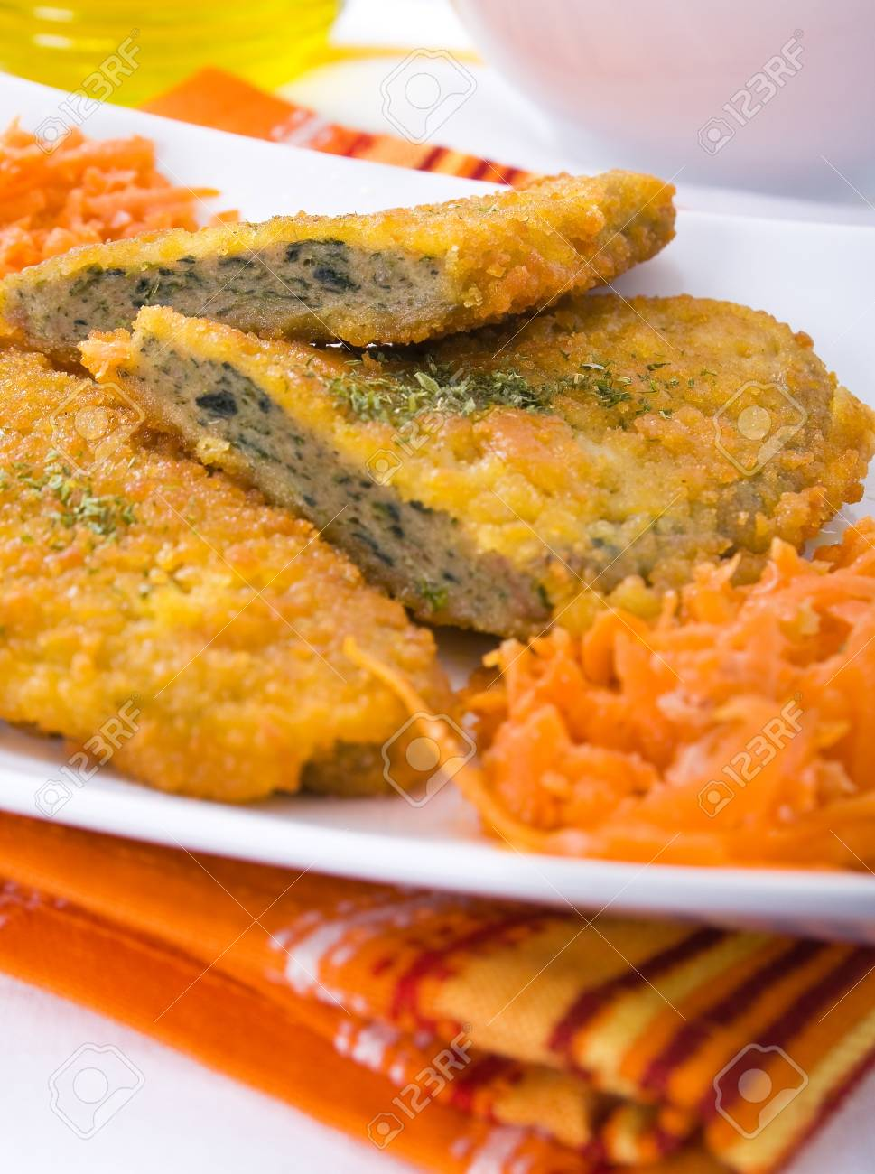 Spinach cutlet on white dish Stock Photo - 12597622