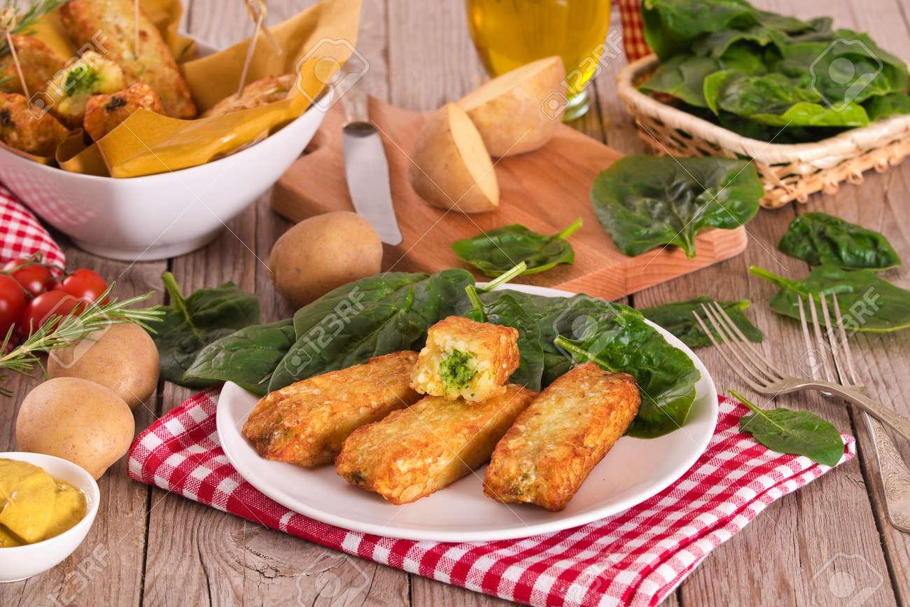 Potato croquettes with spinach and mozzarella. - 128242315