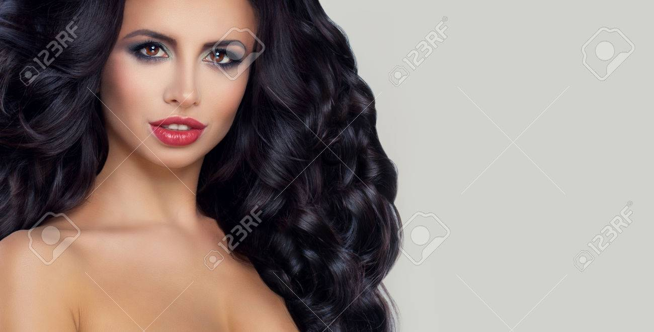 Glamorous Brunette Woman With Curly Hair And Fashion Makeup On Stock Photo Picture And Royalty Free Image Image 70011605