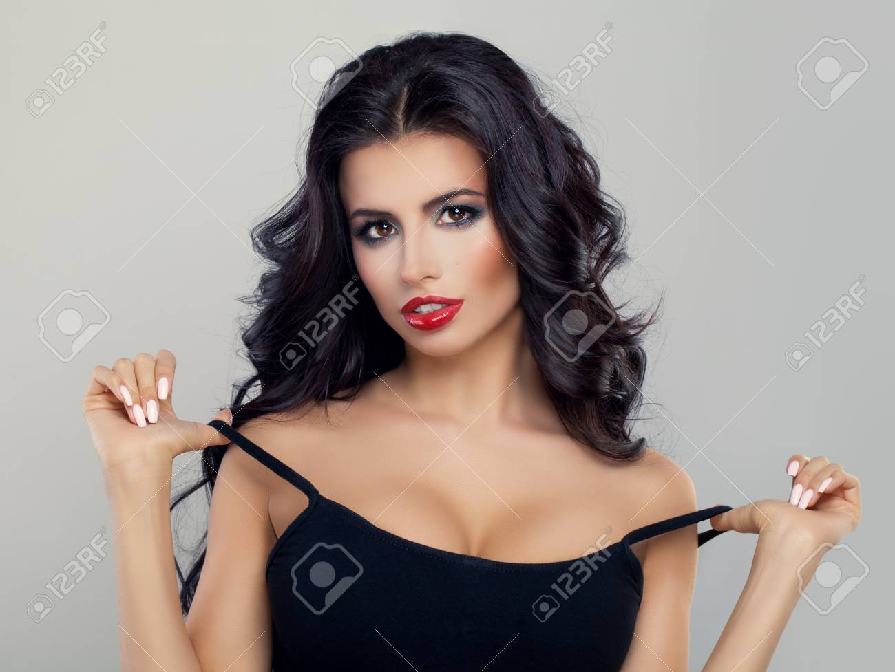 Beautiful Model With Curly Hairstyle Red Lips Makeup And Black