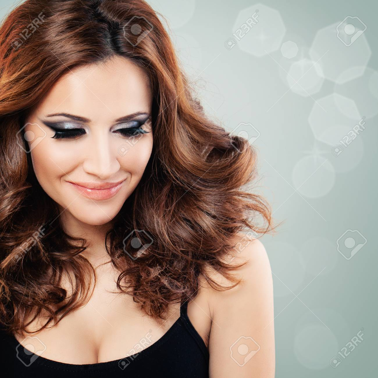 Beautiful Woman With Party Makeup And Red Curly Hair On Background