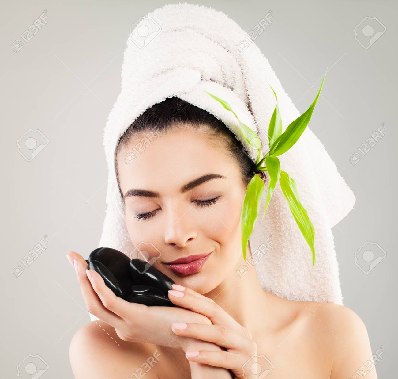 Spa Model Woman With White Bath Towel And Natural Green Leaves ...
