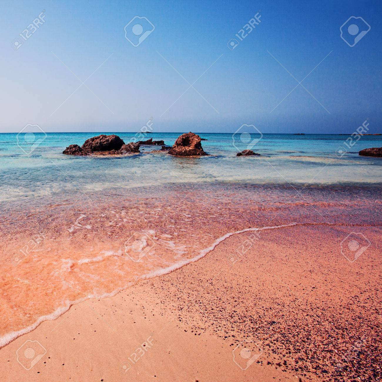 Crete Greece The Wave Of The Sea On The Pink Sand On Beautiful