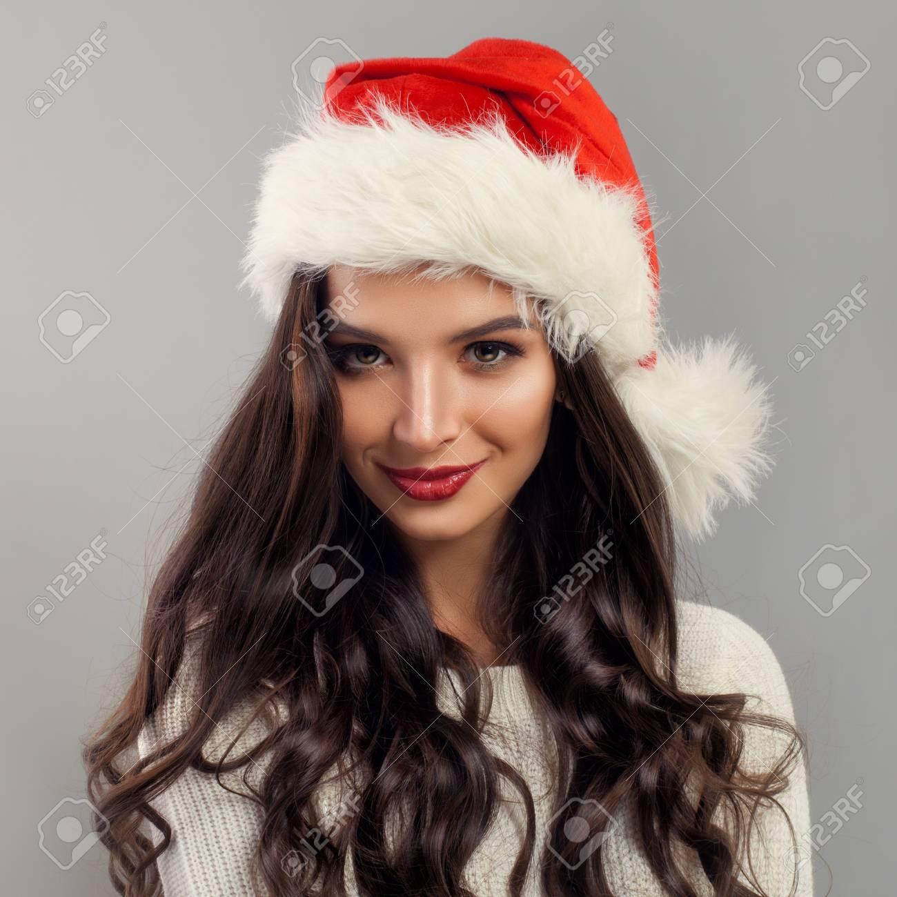 Christmas Model Woman wearing Santa Claus Hat, Beauty Fashion..