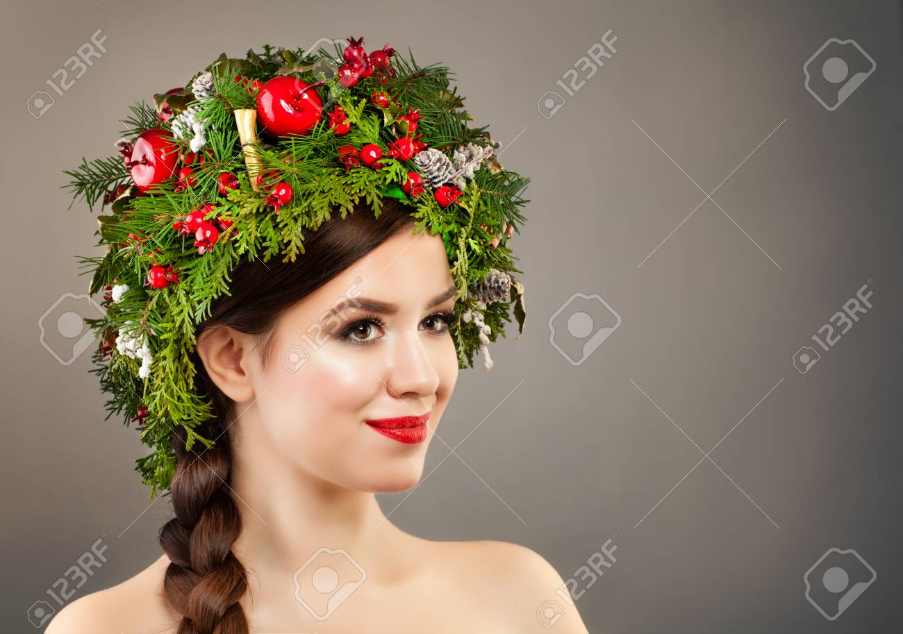 Christmas Woman With Xmas Tree Wreath Makeup And Braid Hairstyle