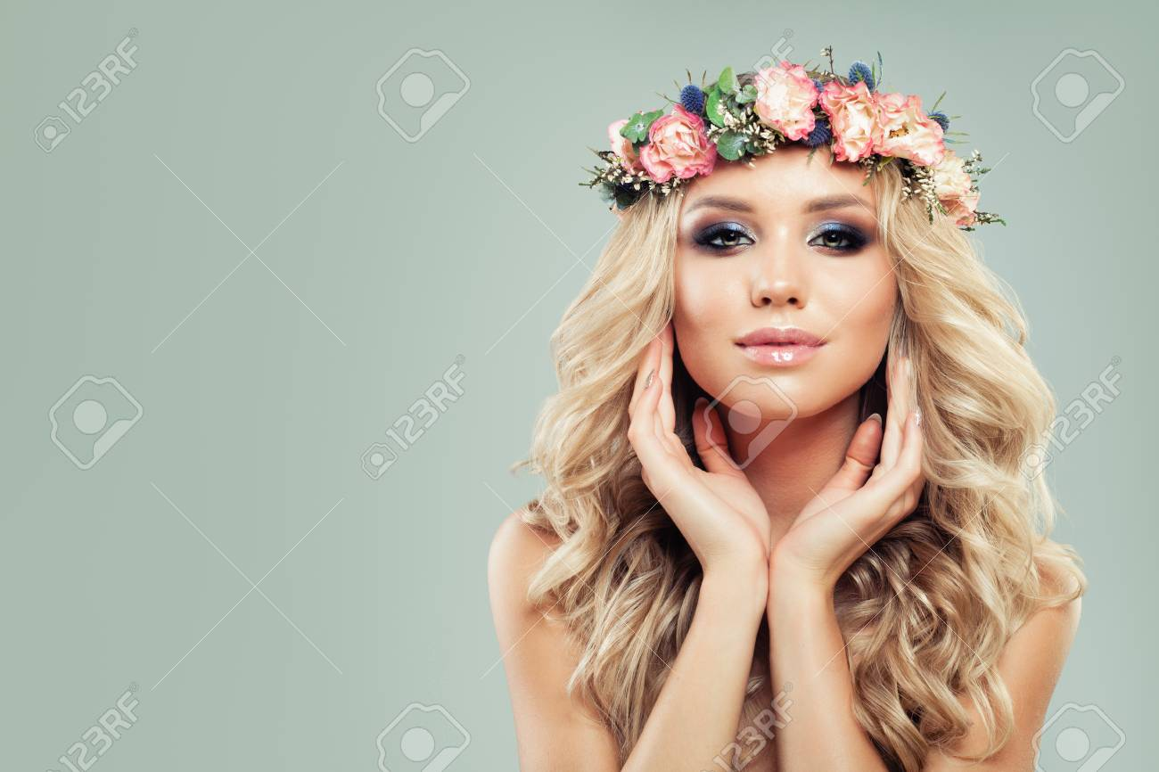 Fashion portrait of beautiful young female model with cute face fashion portrait of beautiful young female model with cute face wavy hair flowers and izmirmasajfo