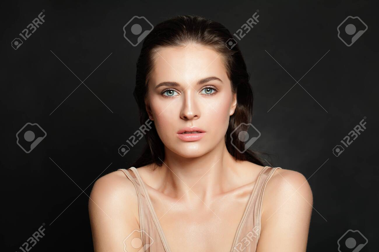 Beautiful woman with natural clear skin on black background - 121138550