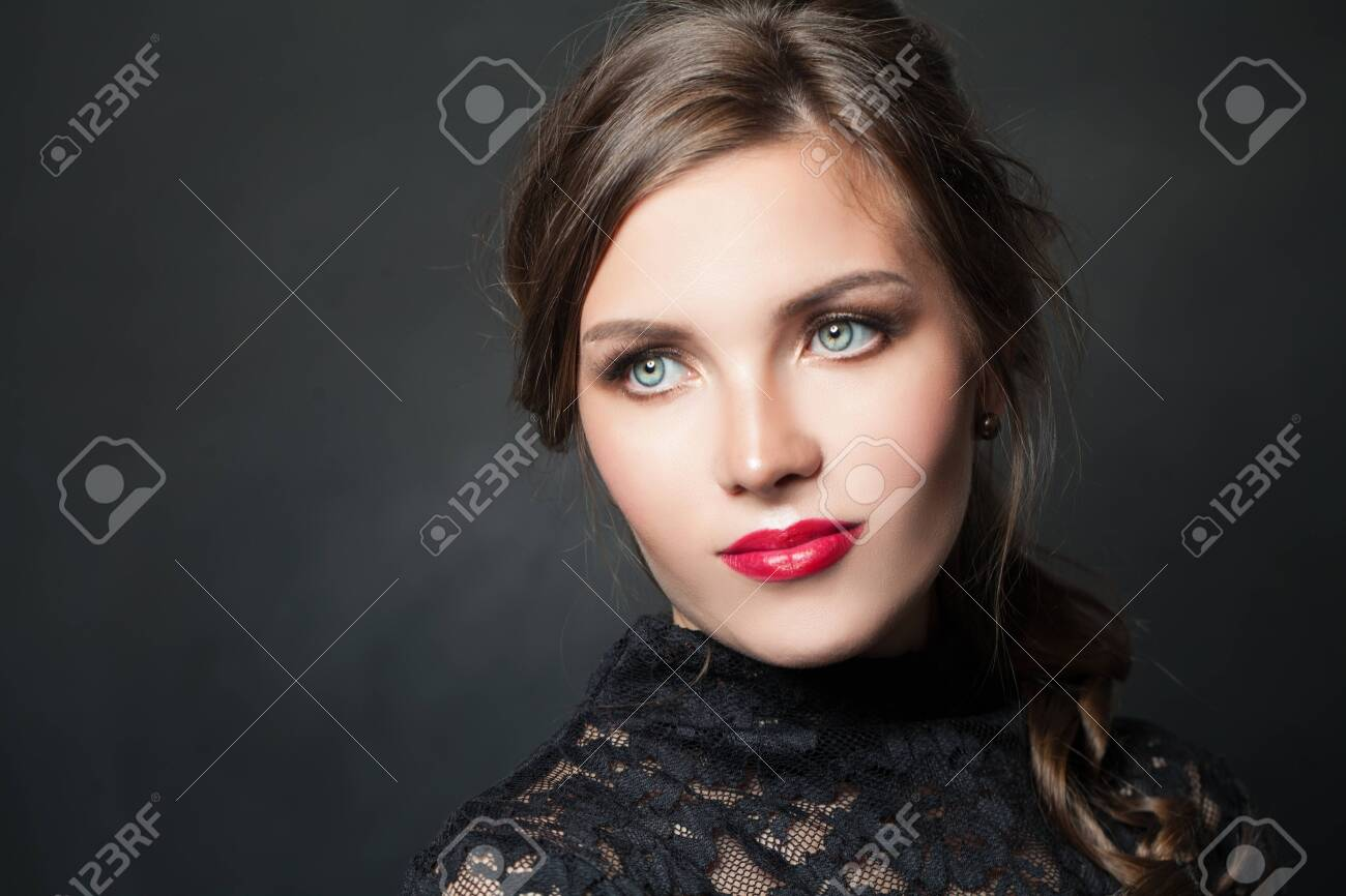 Stylish woman with red lips makeup hair on dark background - 122127444