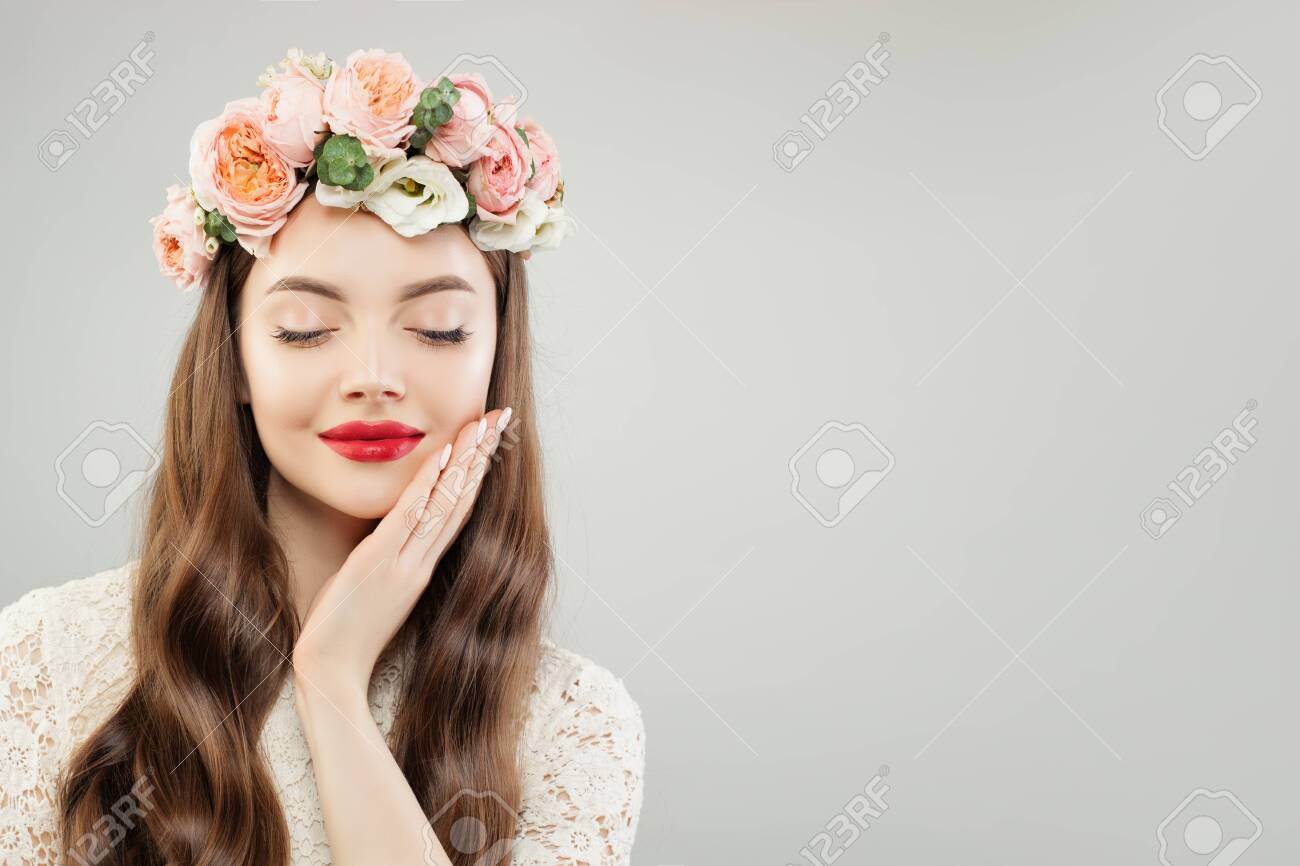 Gorgeous Woman With Makeup Curly Hair And Flowers On White Banner Stock Photo Picture And Royalty Free Image Image 125071977
