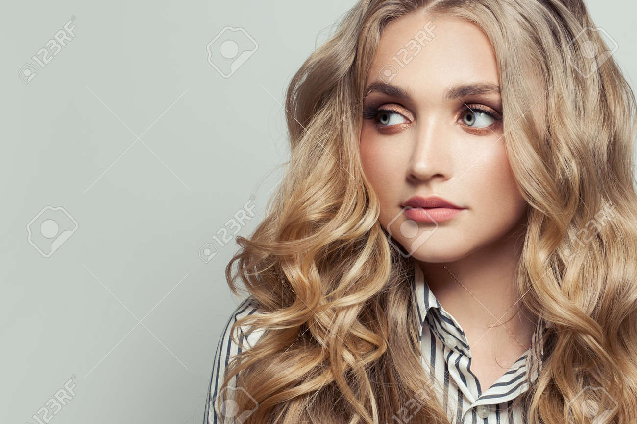 Perfect woman with long curly blonde hairstyle on white - 156491667