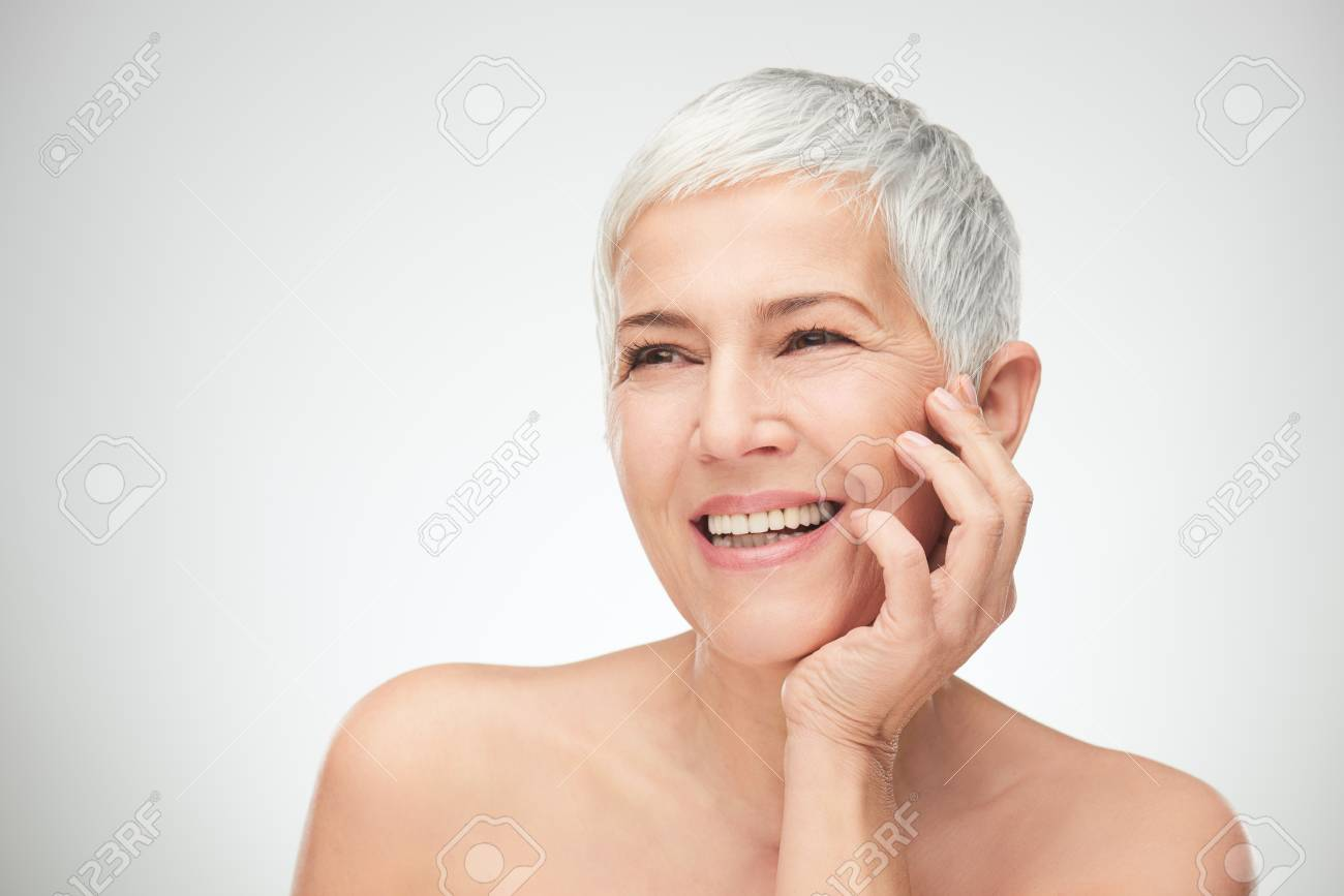 Portrait of beautiful senior woman in front of white background. - 96886287