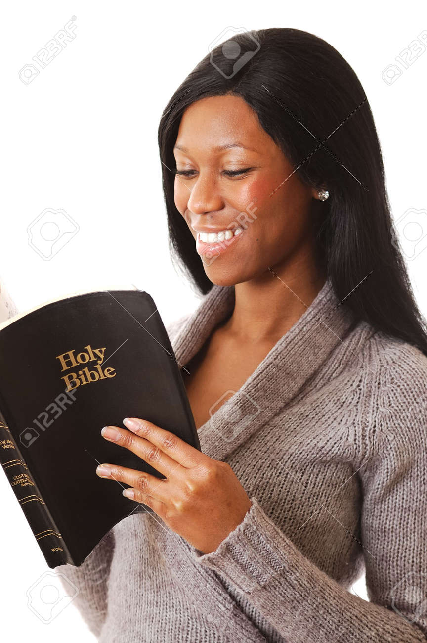 This is an image of a woman reading a bible whilst happy. Stock Photo - 3466297
