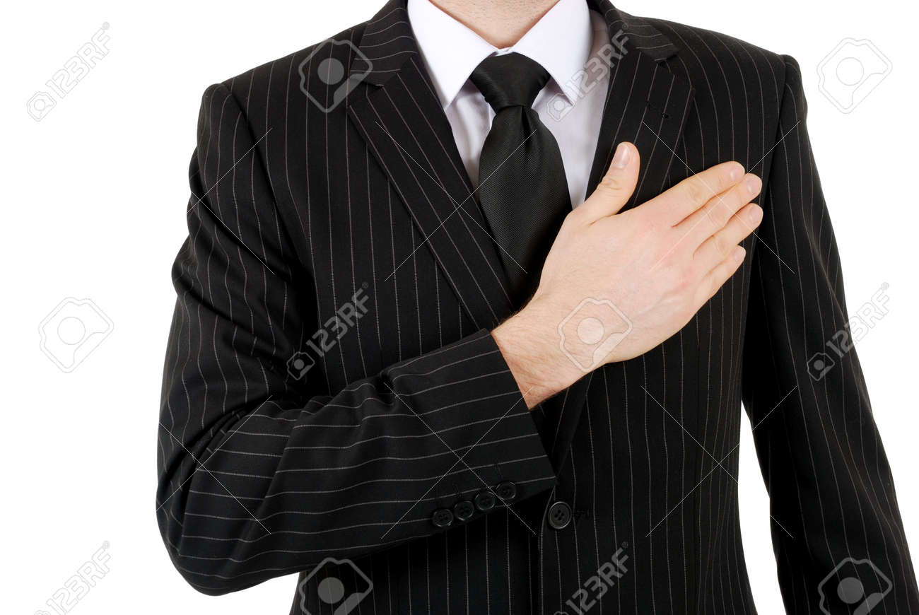 This is an image of business man with hand across his chest. Stock Photo - 5210565