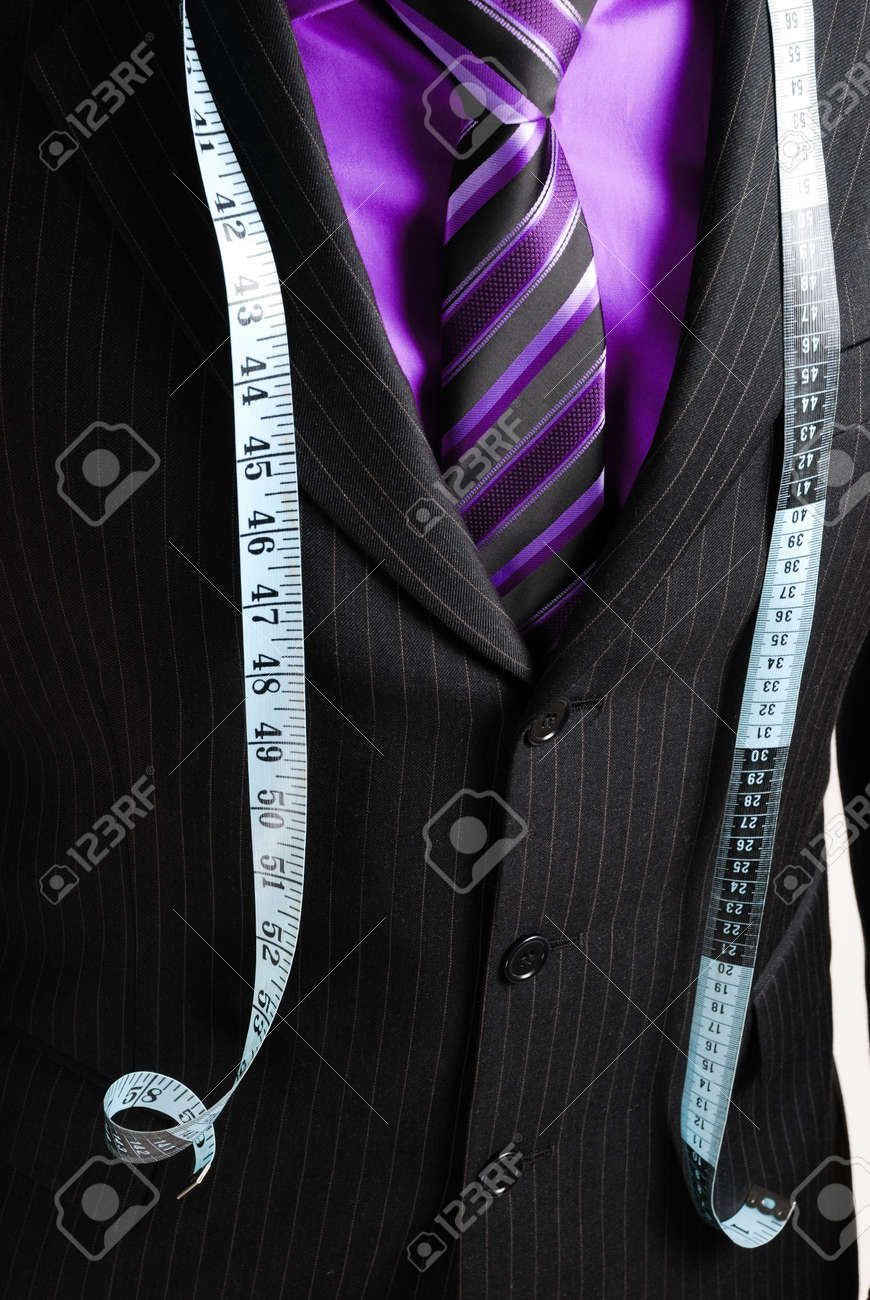 This is an image of business man wearing a tape measure across his suit and shirt.Fashion concept. Stock Photo - 5210616