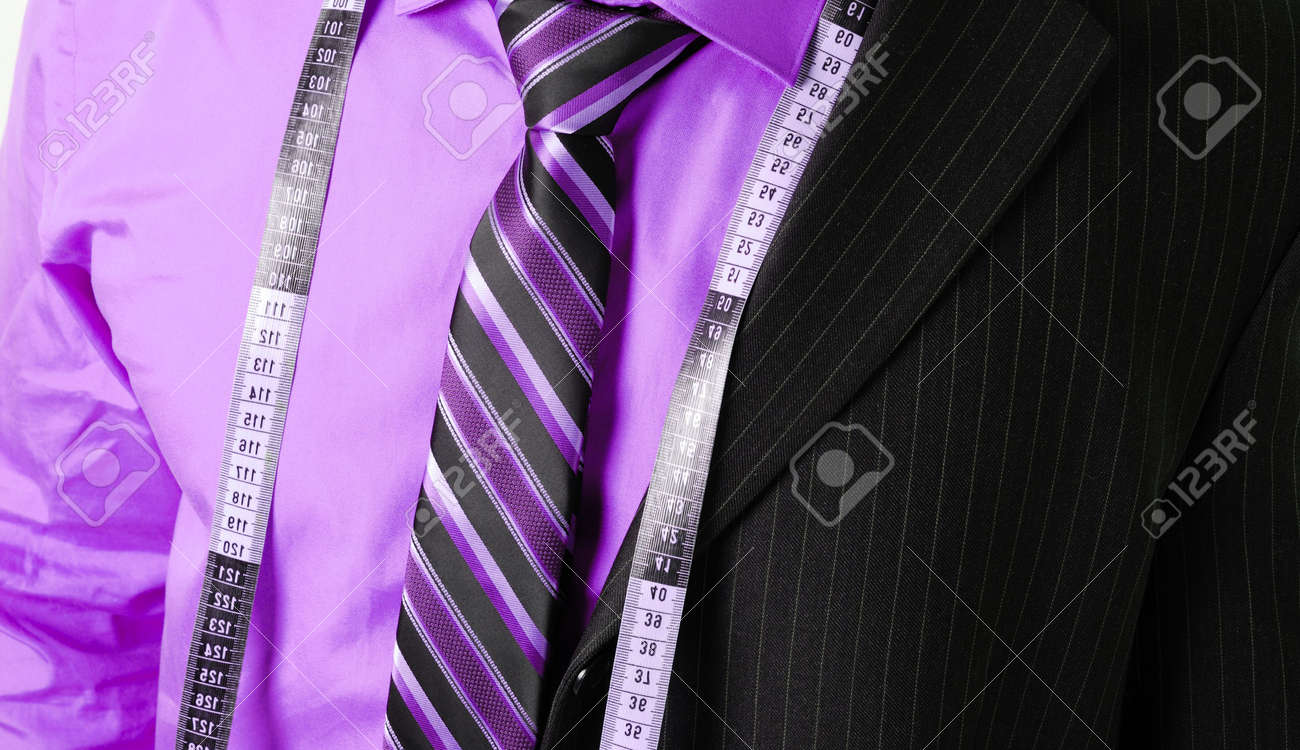 This is an image of business man wearing a tape measure across his suit and shirt.Fashion concept. Stock Photo - 5210598