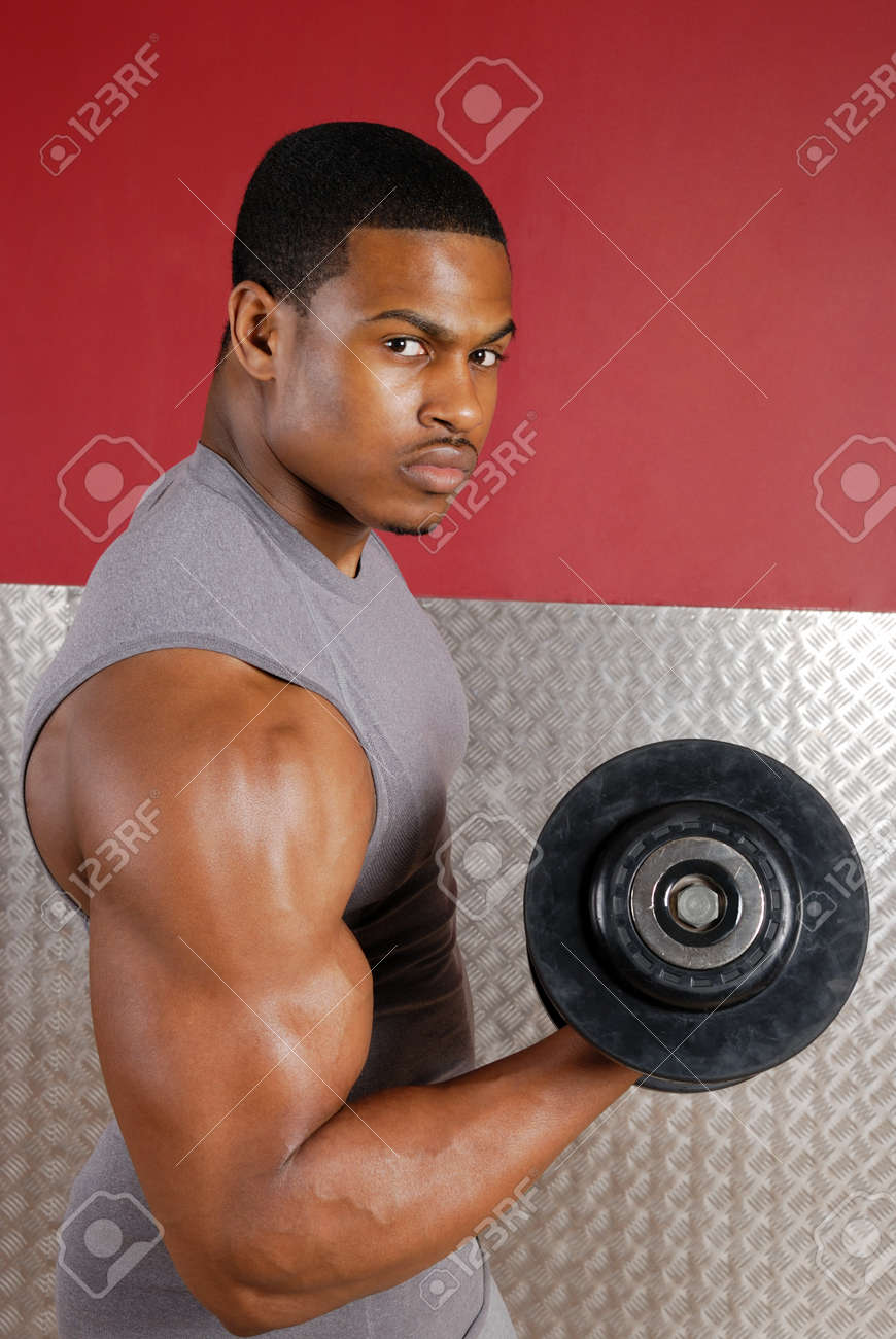 This is an image of a man lifting weights. Stock Photo - 9413448