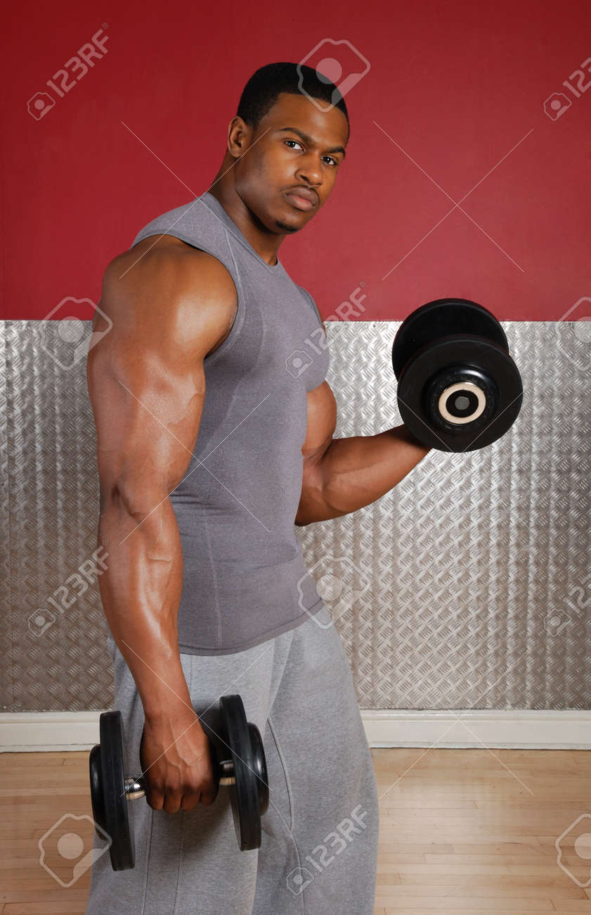 This is an image of a man lifting weights. Stock Photo - 9413374