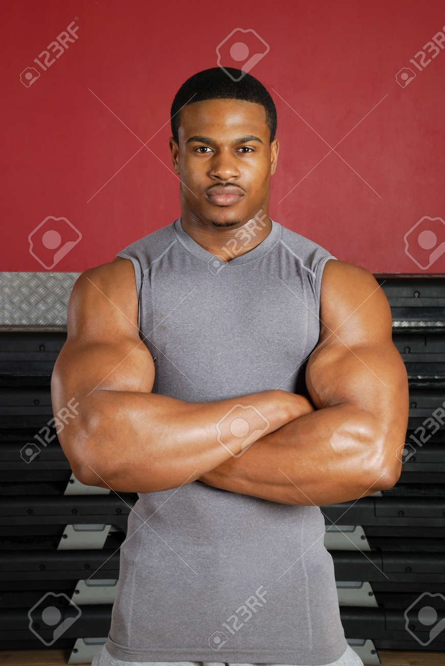 This is an image of a muscular man in the gym. Stock Photo - 9413445