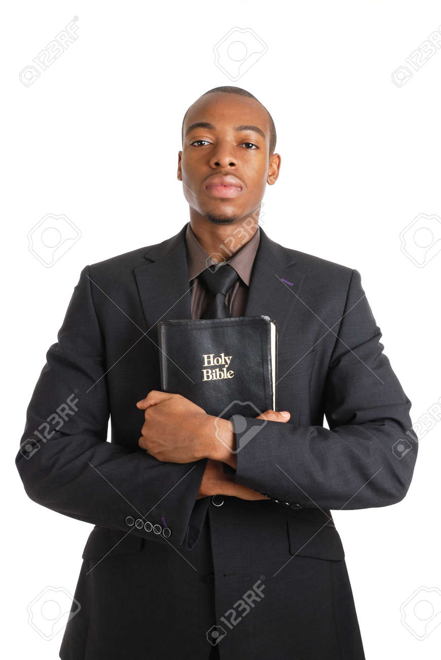 This is an image of a man holding a bible showing commitment. Stock Photo - 9425156