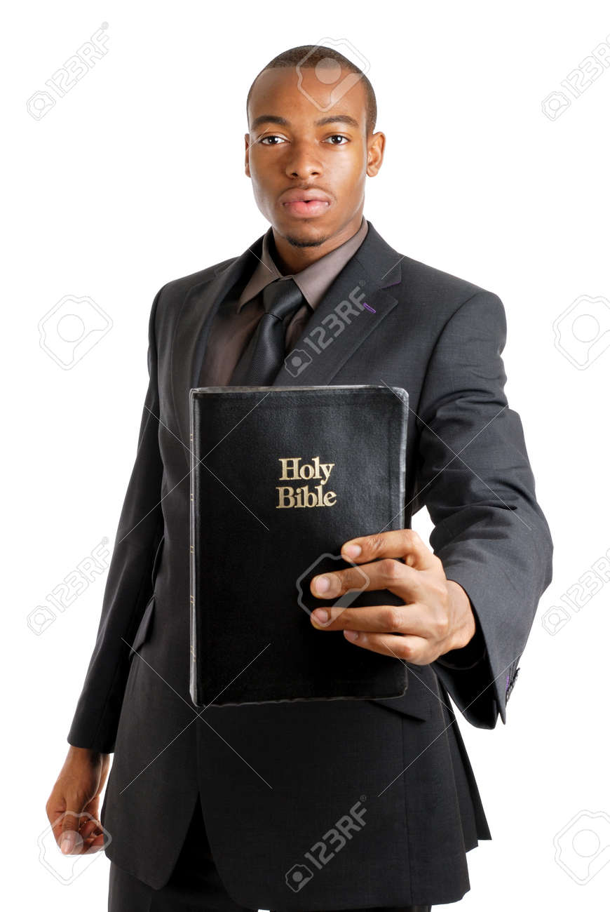 This is an image of a man holding a bible showing commitment. Stock Photo - 9425126