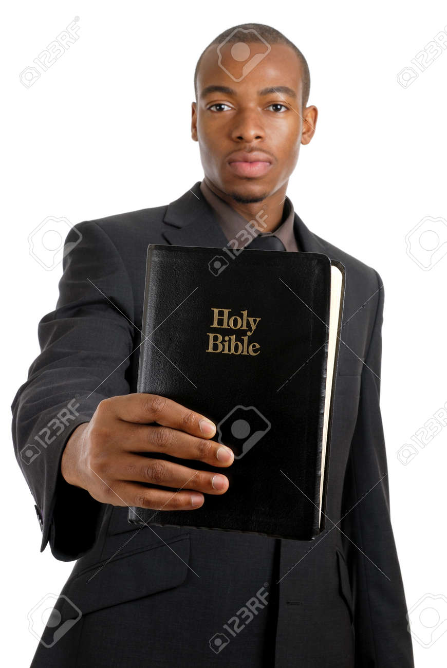 This is an image of a man holding a bible showing commitment. Stock Photo - 9425159