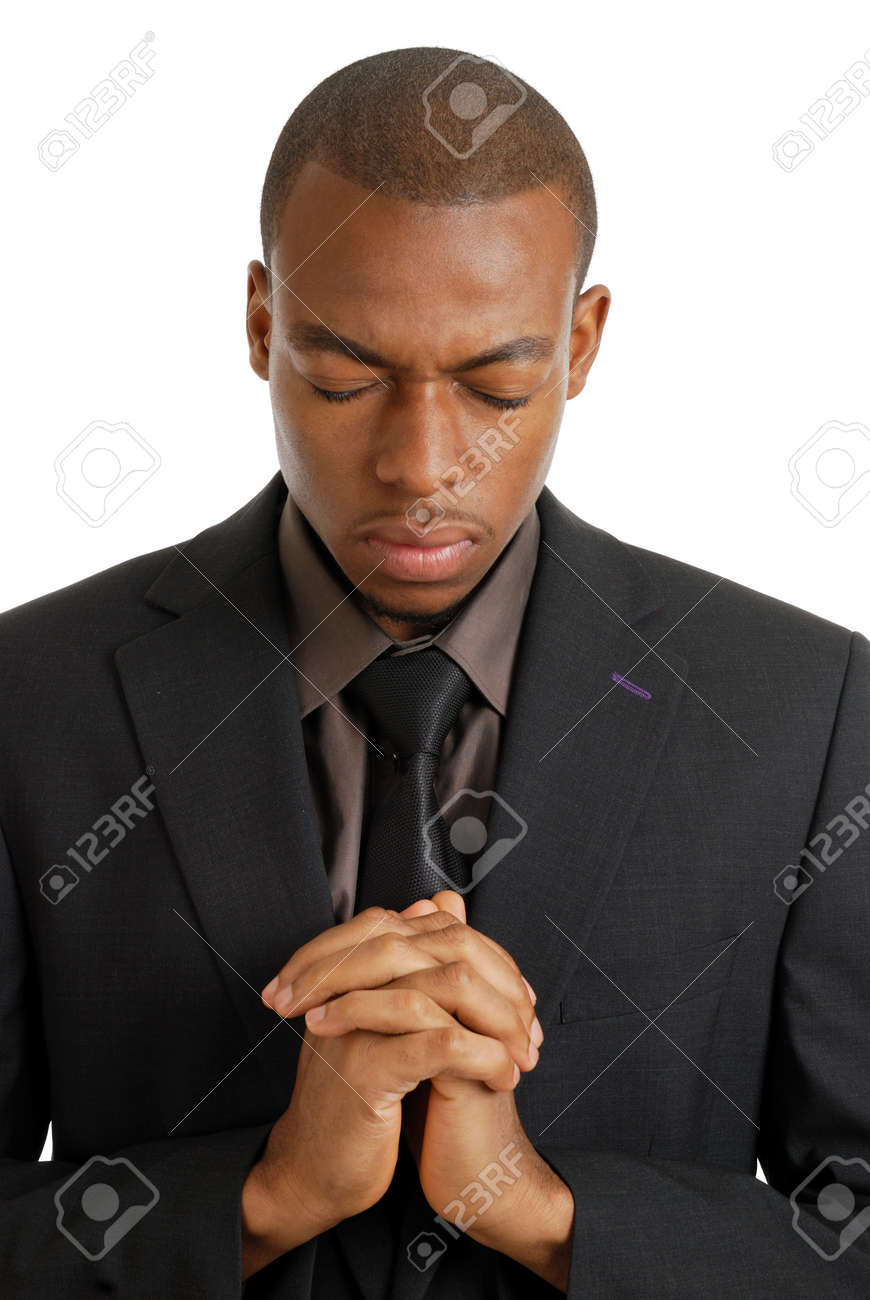 This is an image of a business man praying, using prayer gesture. Stock Photo - 9425217