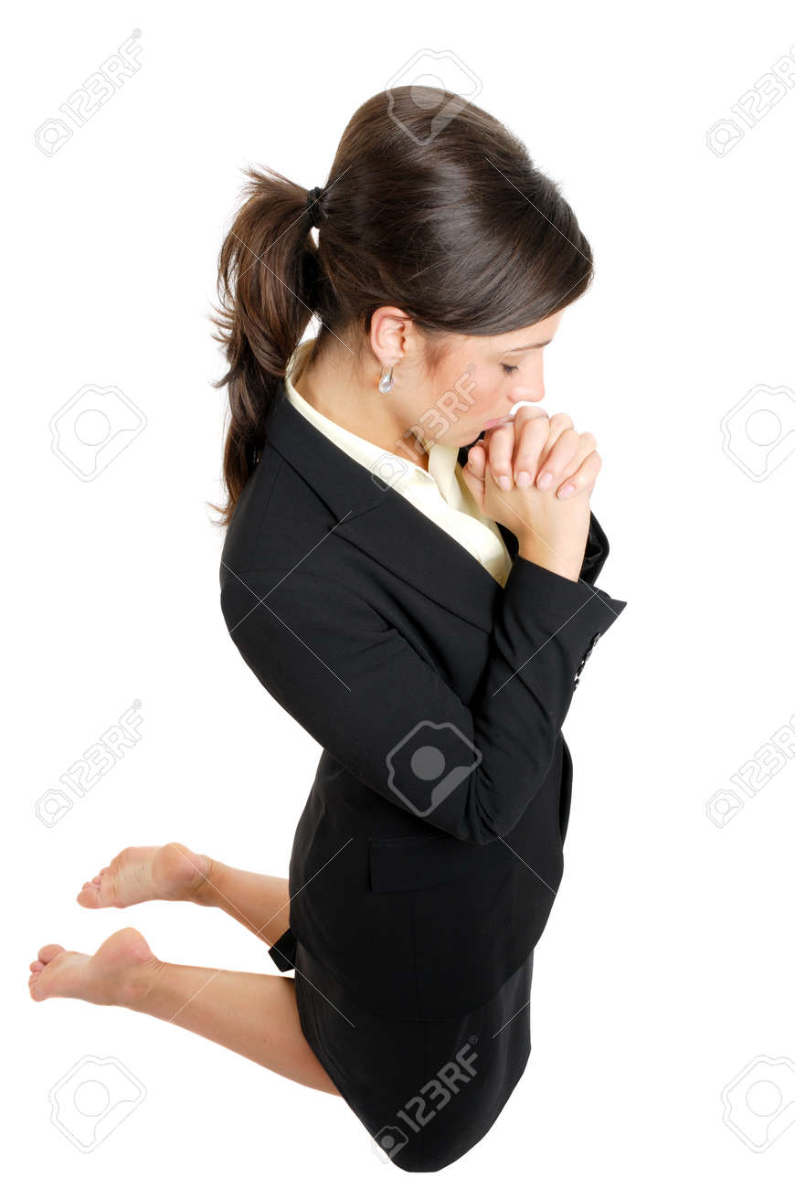 This is an image of business woman kneeling and praying. Stock Photo - 9425127