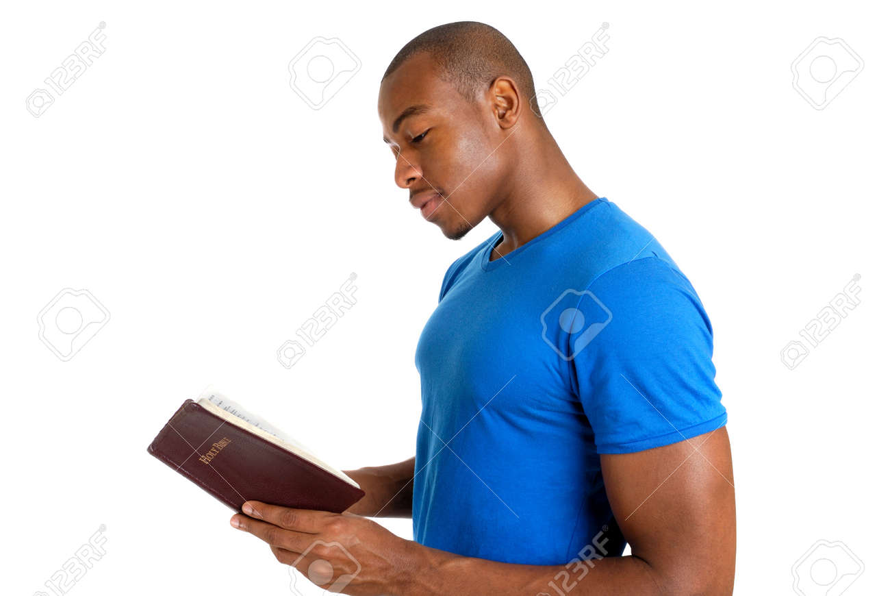 This is an image of young man studying the bible. Stock Photo - 9425132