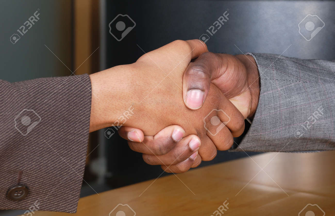 This is an image of male and female handshake at a business reception. Stock Photo - 9436667