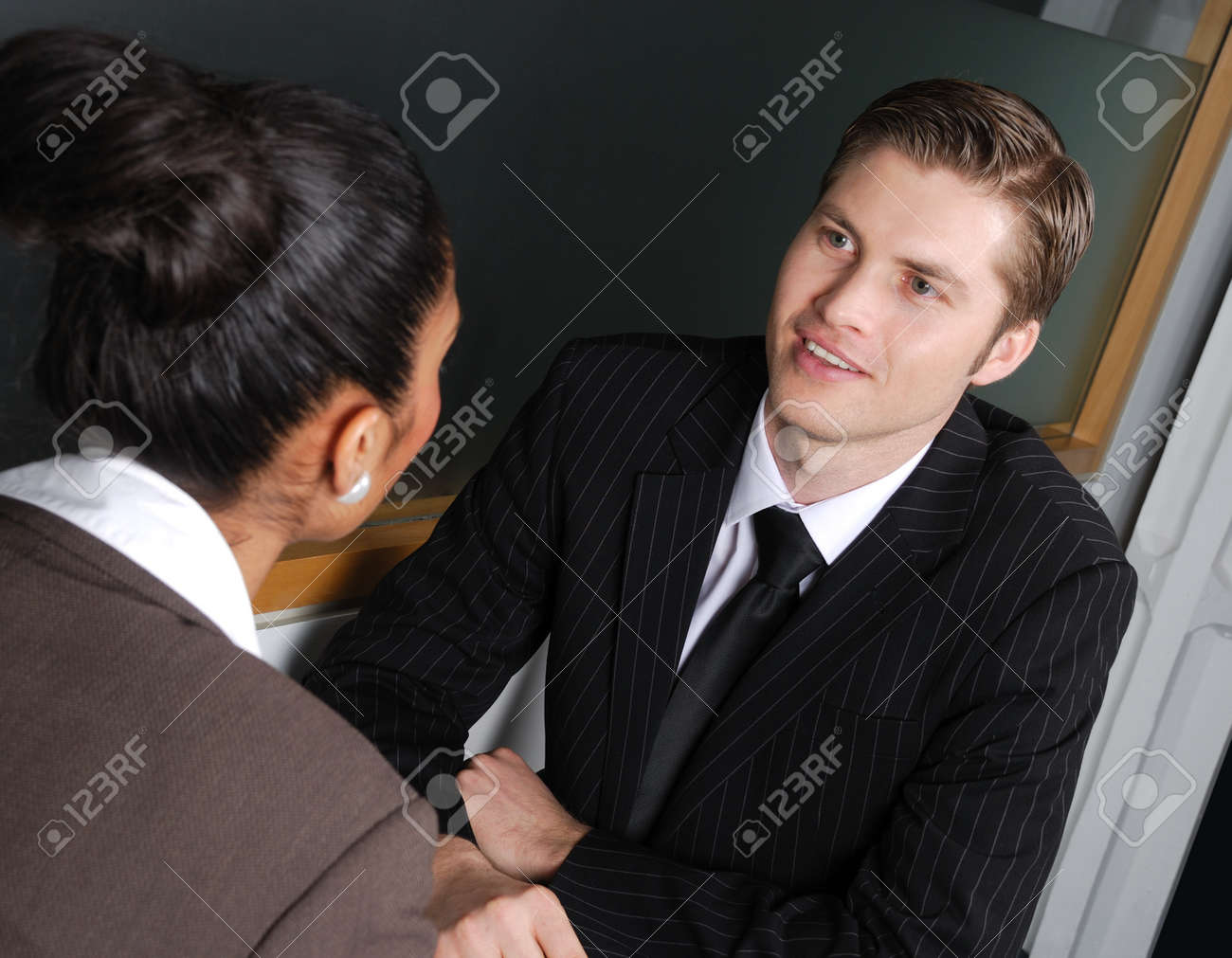 This is an image of a business team having a discussion. Stock Photo - 9436572