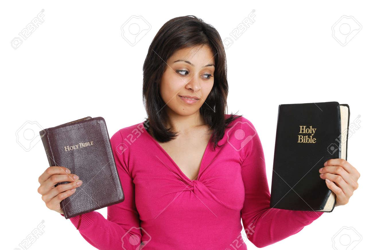 This is an image of female student holding two bibles. Stock Photo - 9436669