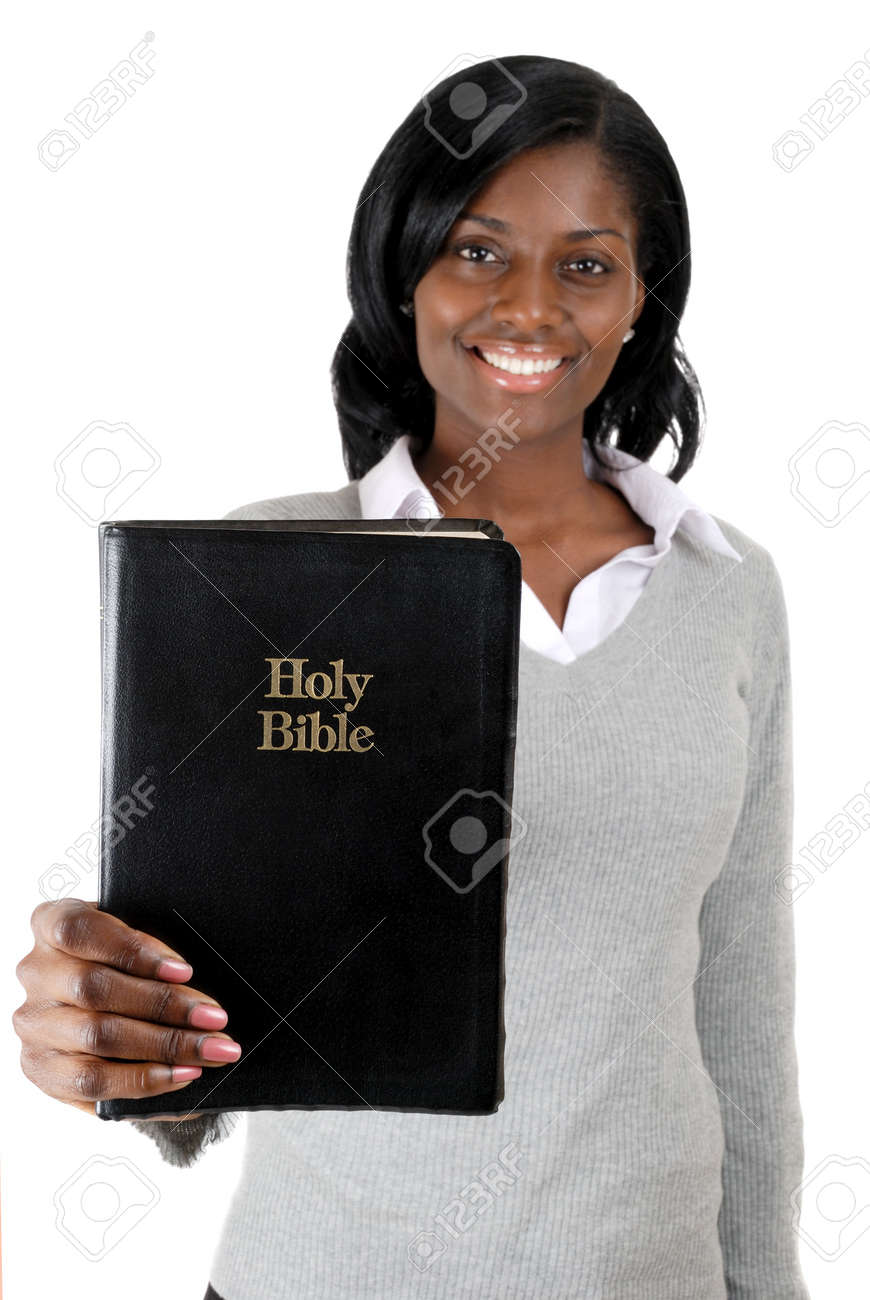 This is an image of woman smiling with a bible. Stock Photo - 9436547