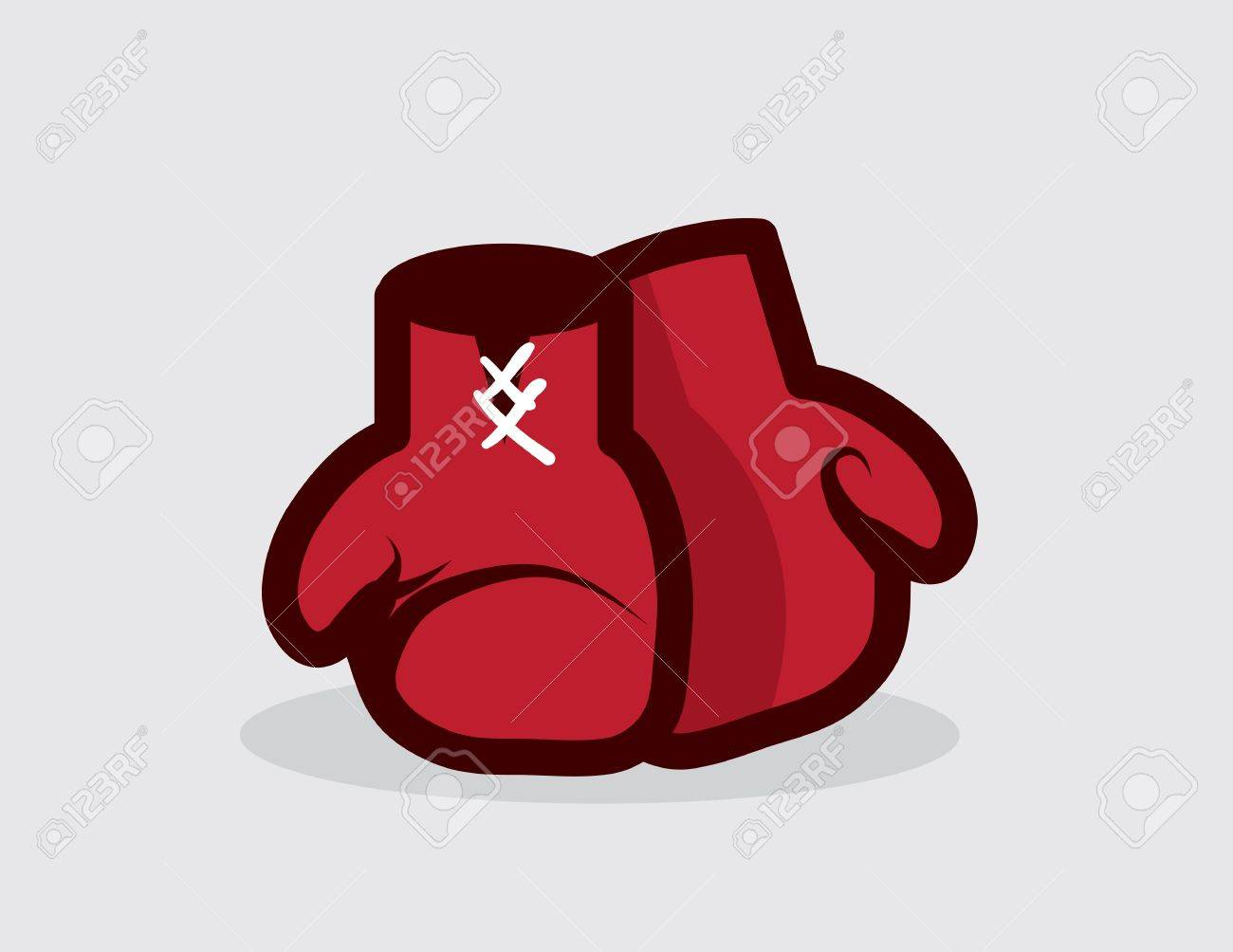 Boxing gloves sitting on the ground Stock Vector - 19895137