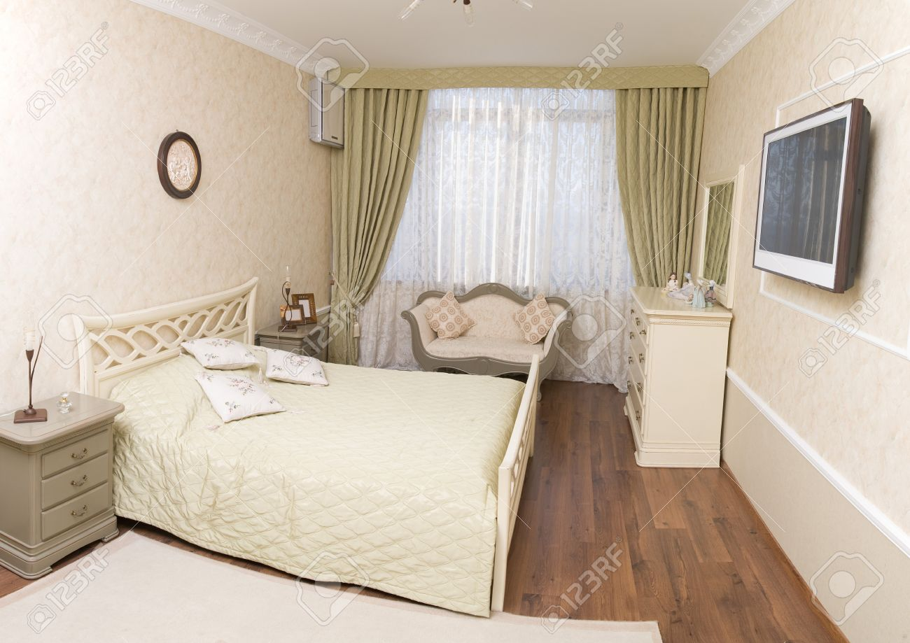 Bright bedroom in the style of the 50s  with a double bed and flat TV. Bright Bedroom In The Style Of The 50s  With A Double Bed And