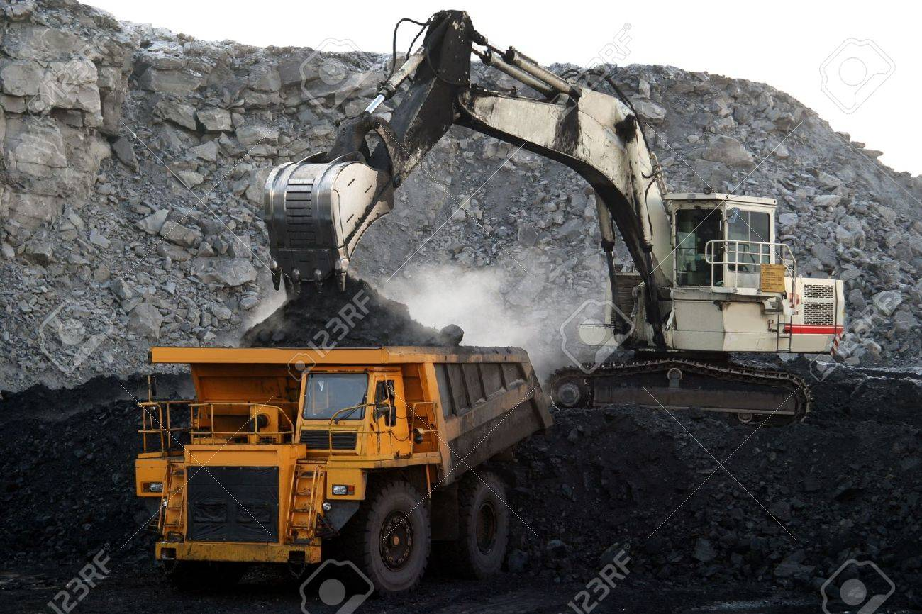 A picture of a big yellow mining truck at worksite - 16332113