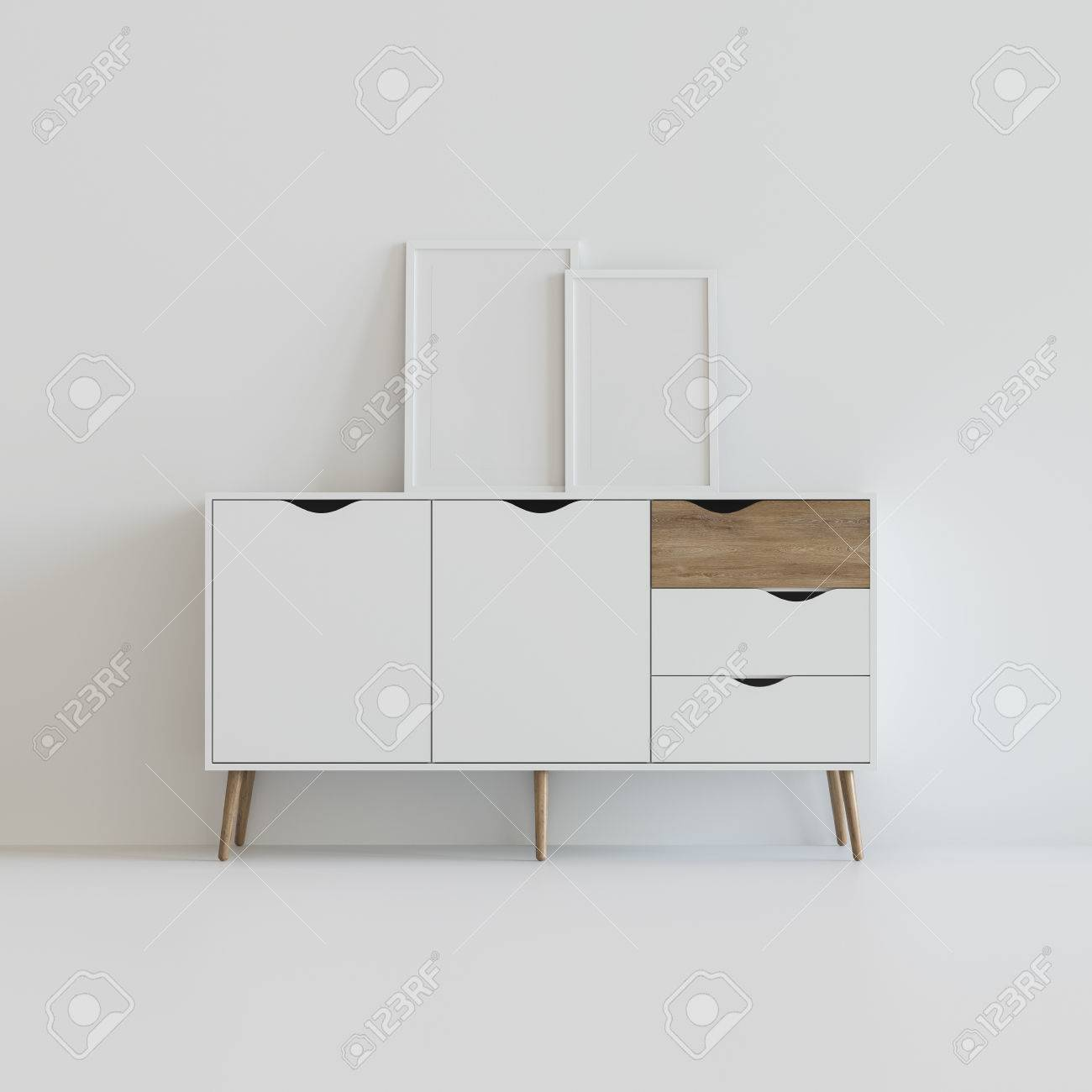 Drawer In White Space With Picture Frames On It Stock Photo, Picture ...