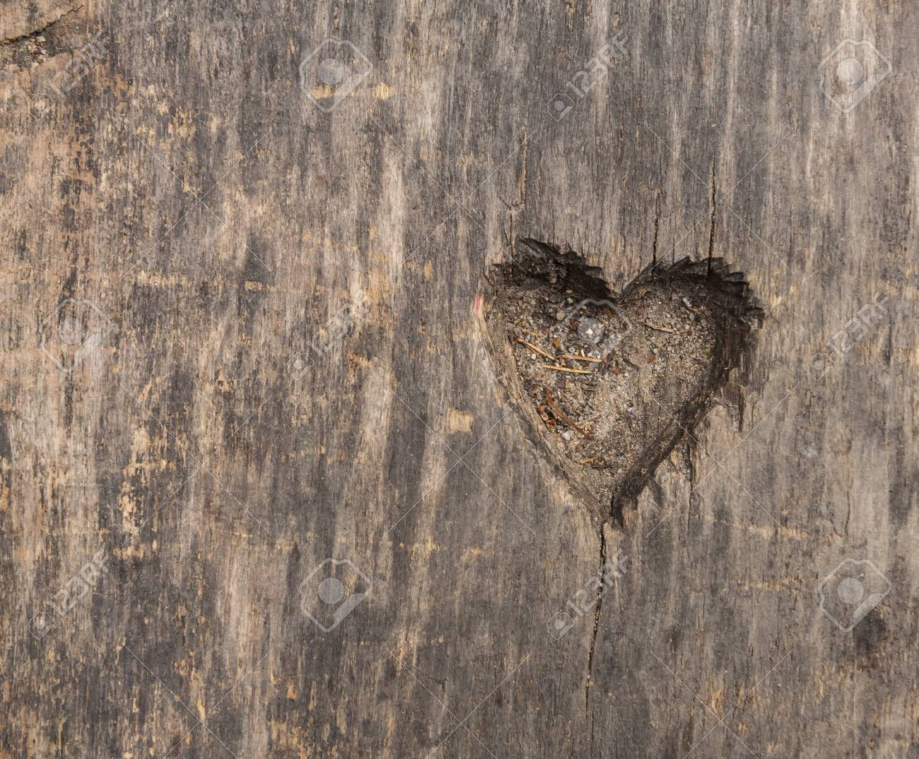 Small heart shape cut in old wood. Picture useful as background - 37946083