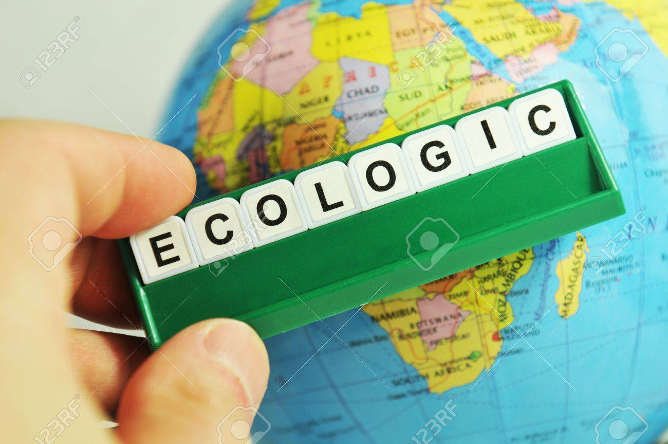 Ecologic concept with message on game board and Earth globe in background Stock Photo - 10397983