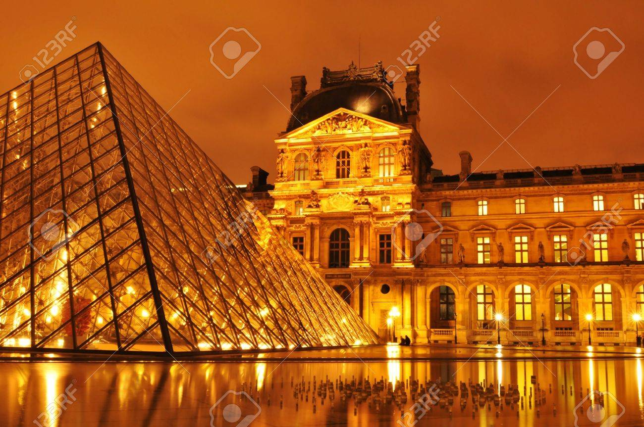 Paris, France - March, 2011: Night view of Louvre Museum with the famous glass pyramid, the main touristic attraction in Paris and one of the most visited landmarks around the world Stock Photo - 10484569