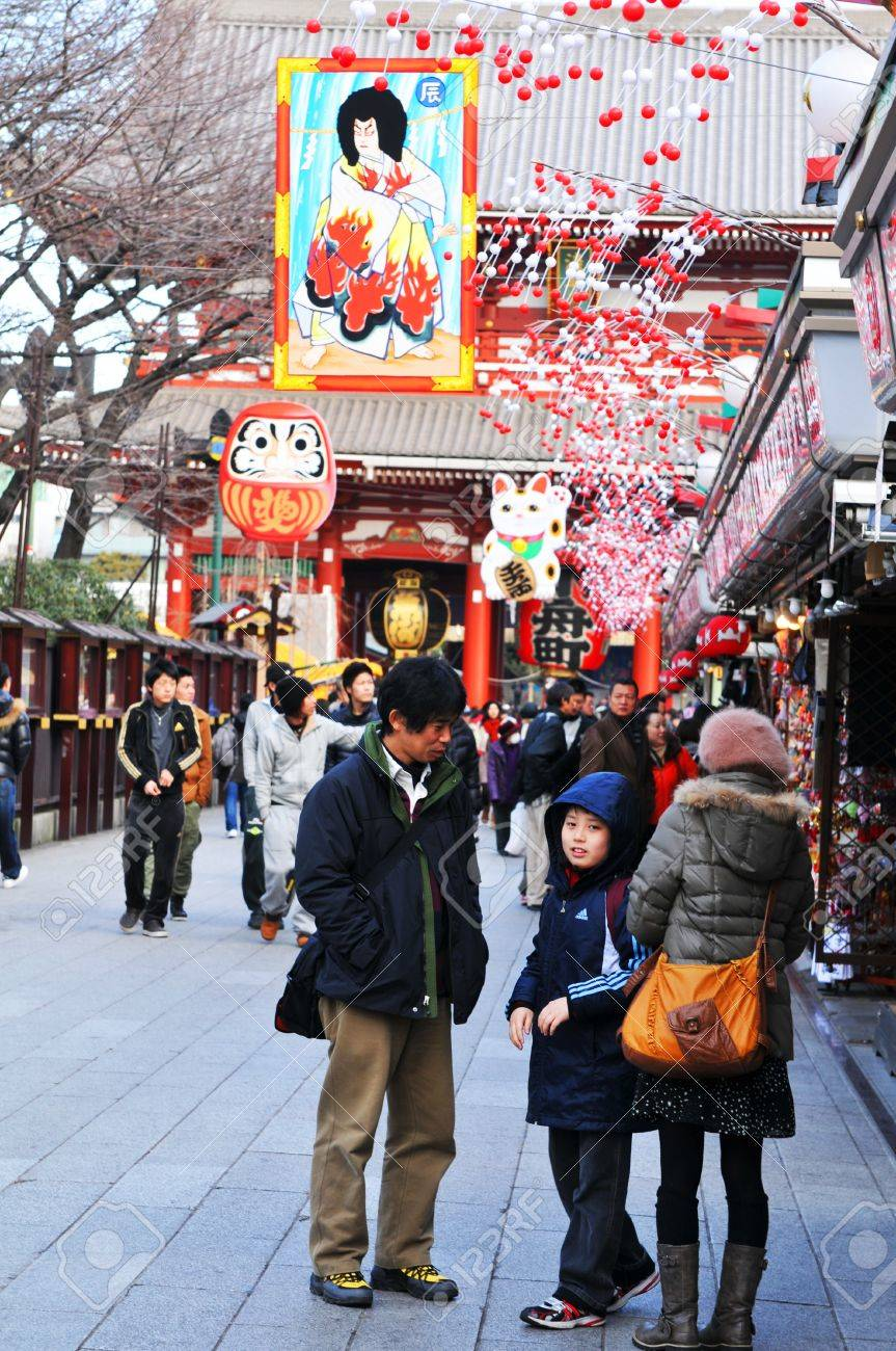 Tokyo, Japan - 1 January, 2012: Japanese family making their traditional trip to a temple in the first day of the New Year (Hatsumode) Stock Photo - 13162098