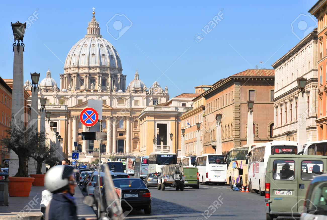 Vatican City - 28 March, 2012: Tourists sightseeing Saint Peter (San Pietro) basilica and square in Vatican Stock Photo - 13266212