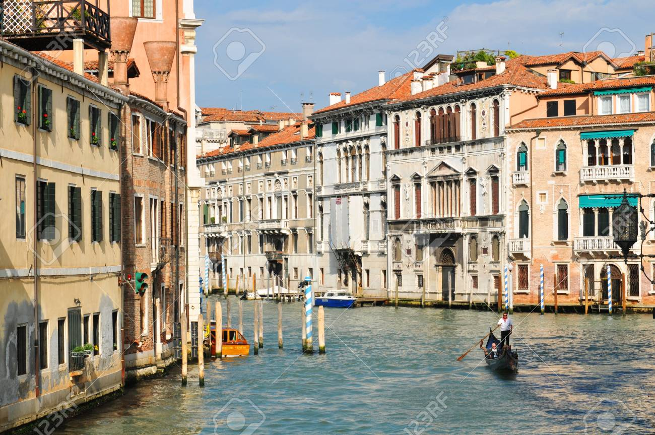 Venice, Italy - 6 May, 2012: Venetian palace (palazzo) overlooking the Grand Canal in central Venice Stock Photo - 14145535