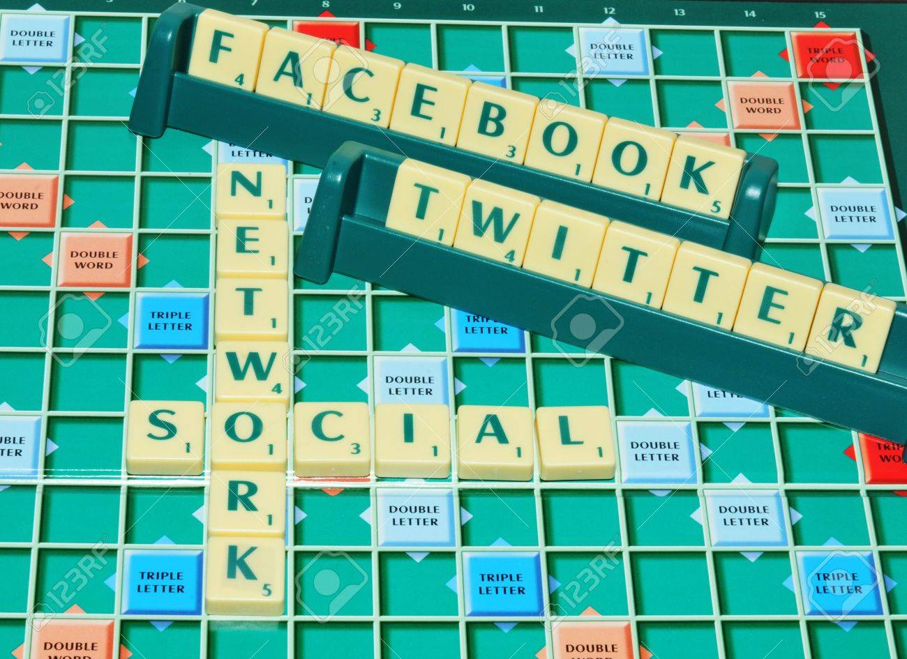London, UK - 11 June, 2012: Social network concept with Facebook and Twitter on game board - 14515021