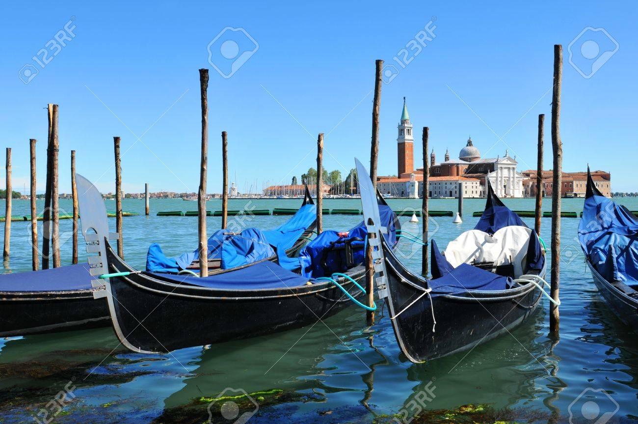 Venice, Italy - 06 May, 2012:  Gondolas overlooking the famous San Giorgio Maggiore basilica in Venice, Italy  Stock Photo - 17118792