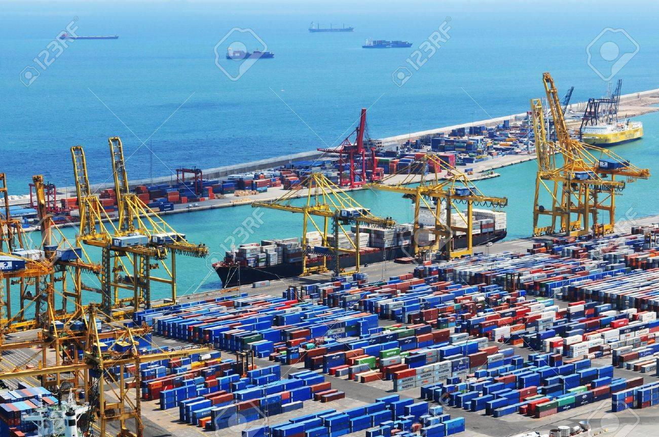 Barcelona, Spain - 05 July, 2012: Aerial view of harbour with cargo containers waiting to be loaded - 14881650