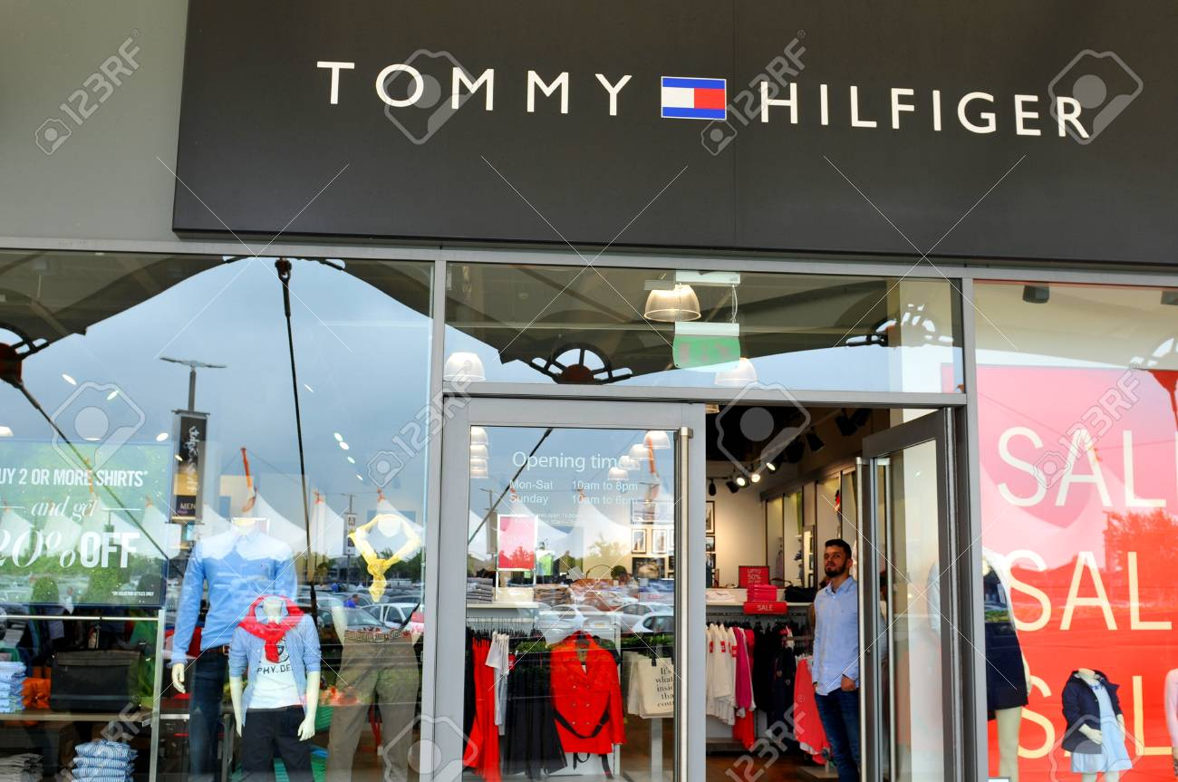 4e9c9c21 London, UK - June 14, 2015: People pass by the Tommy Hilfiger shop