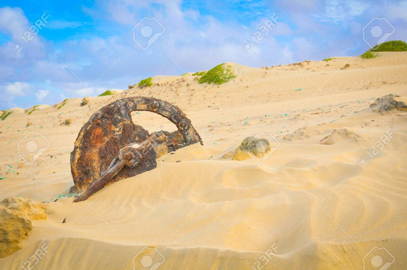 View of desert landscape with dunes and rusty wheel - 96293003