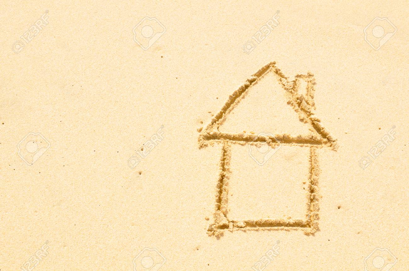 Home insurance concept with a house drawn on the beach - 96362067