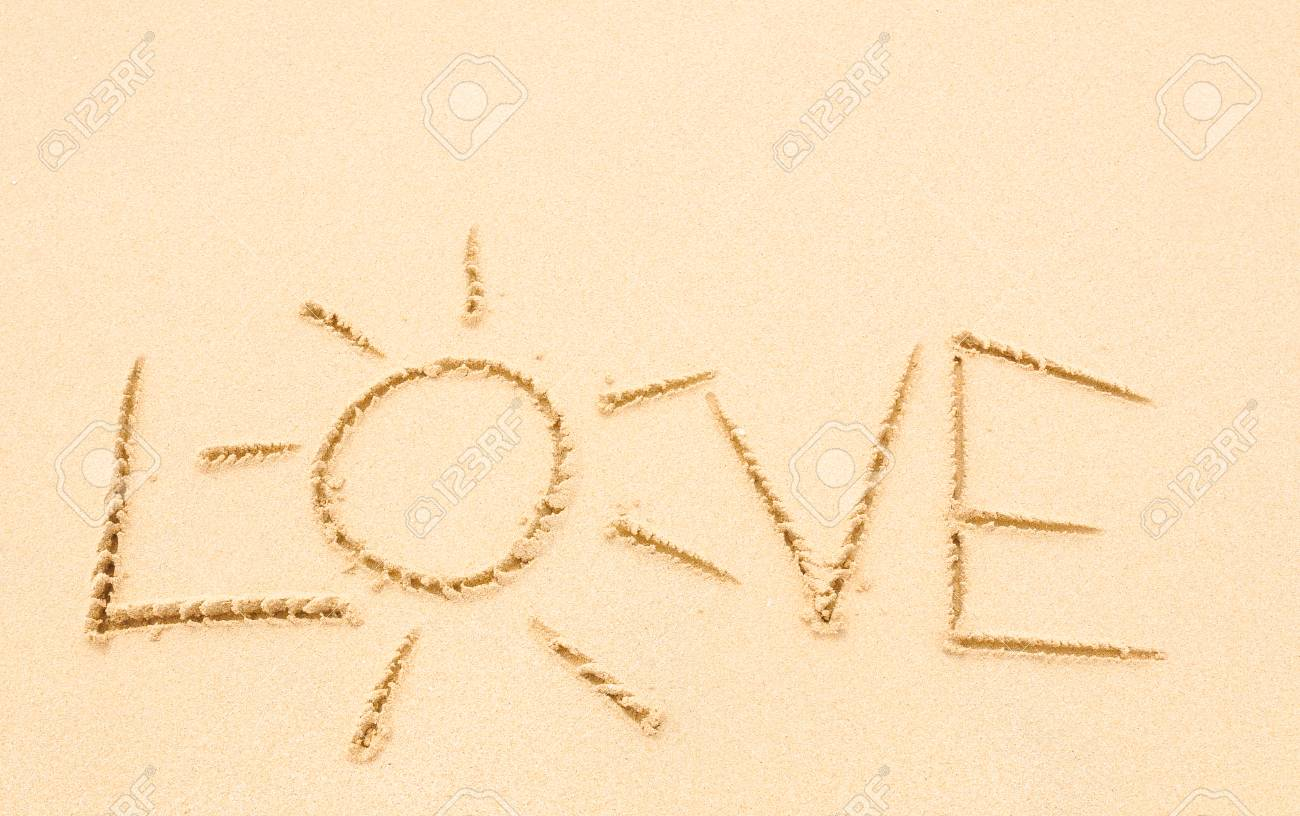 Love written on the sand of an exotic beach - 96362064