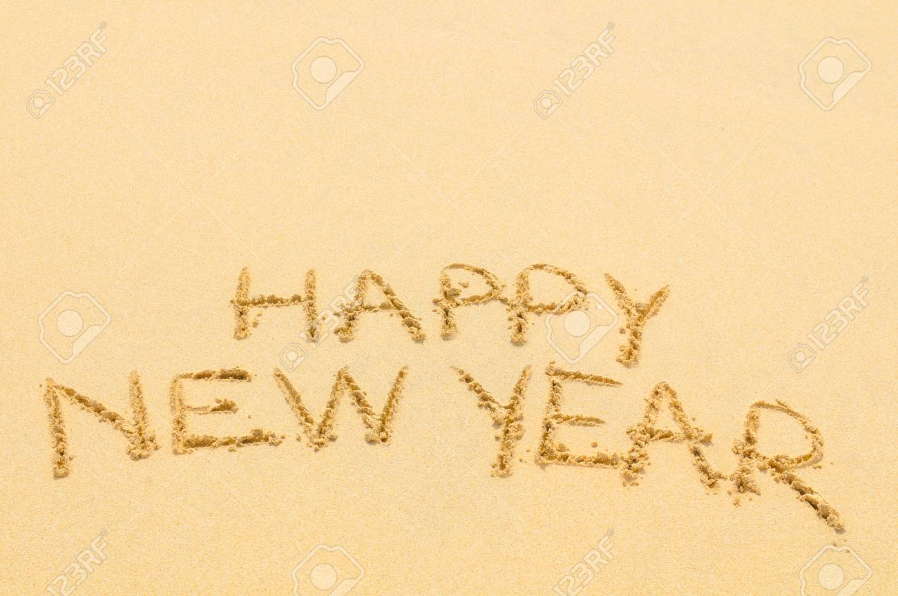 Happy New Year written on sand of an exotic beach - 96398699
